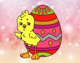 Sympathetic chick with Easter egg