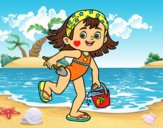 Little girl with beach bucket and spade